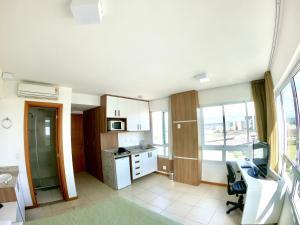 A kitchen or kitchenette at Saint Moritz com vista espetacular de Brasília
