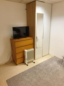A television and/or entertainment center at Appartement Hotel Marien-Hof