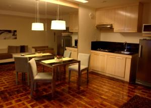 A kitchen or kitchenette at Prince Plaza II Condotel