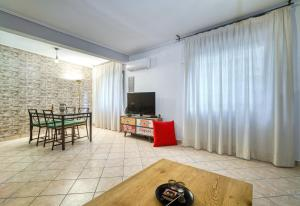 A television and/or entertainment centre at Athens metro apartment