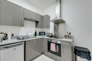A kitchen or kitchenette at Old Bill Apartments Anfield Liverpool