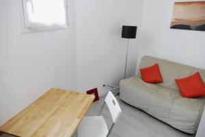 O zonă de relaxare la Bel appartement dans maison au bourg