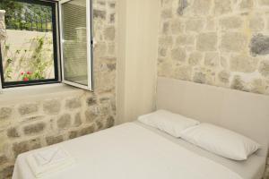 Postel nebo postele na pokoji v ubytování Villa Andrea