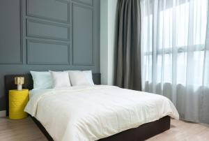 A bed or beds in a room at Arte Plus by Afflexia Serviced Suites KLCC