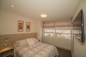 Säng eller sängar i ett rum på KECHUAS RESIDENCE