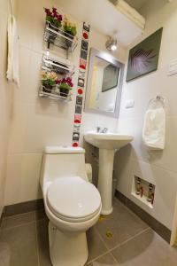 Ett badrum på KECHUAS RESIDENCE