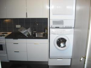 A kitchen or kitchenette at Guesthouse Lena Apartment
