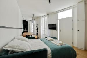 Lova arba lovos apgyvendinimo įstaigoje Suite Beata