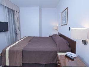 Cama o camas de una habitación en Apart Hotel Diego De Almagro
