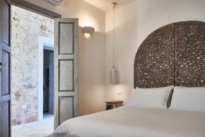 A bed or beds in a room at Casolare degli Ulivi