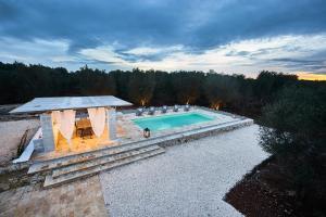 The swimming pool at or near Casolare degli Ulivi