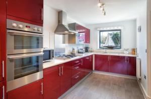 A kitchen or kitchenette at South Sands Beach House