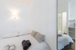 Un ou plusieurs lits dans un hébergement de l'établissement Le Pavillon Bleu
