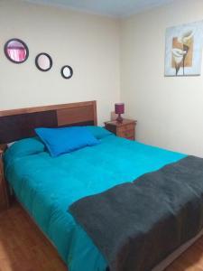 Cama o camas de una habitación en Apartamentos Turisticos Cavalcanti