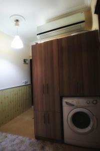 A kitchen or kitchenette at Jalal Vip Apart Hotel