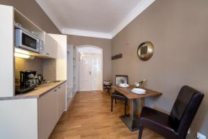 Η κουζίνα ή μικρή κουζίνα στο Old Town - Aparthotel Michalska