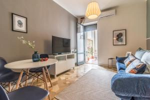 A seating area at Homeathotel Citylife Colonna