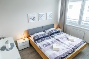 Posteľ alebo postele v izbe v ubytovaní The Town Hall Residence -Welcome Home Apartment -free parking -A/C