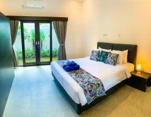 Cama ou camas em um quarto em Residence 888 Ubud, Villa 5