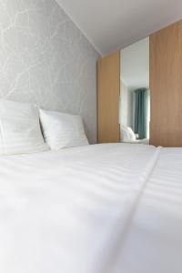Łóżko lub łóżka w pokoju w obiekcie Baltic Apartments Main Town Towers