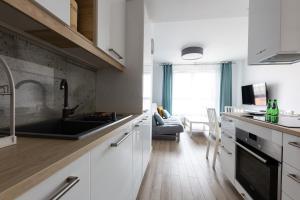 Kuchnia lub aneks kuchenny w obiekcie Baltic Apartments Main Town Towers