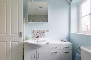 A bathroom at Riverside cottage