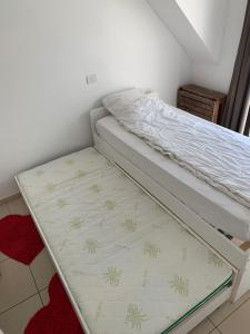 A bed or beds in a room at Villa D'este