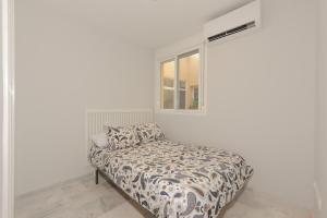 A bed or beds in a room at Apartment Lirio Casares Golf Canovas