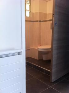 Ein Badezimmer in der Unterkunft Gîte Polema