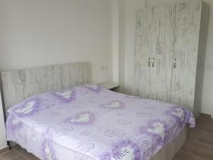 A bed or beds in a room at Zoga Apartments