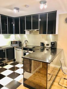 A kitchen or kitchenette at Piccadilly Circus Apartments