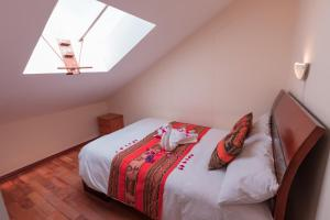 Cama o camas de una habitación en Quechua ApartHotel
