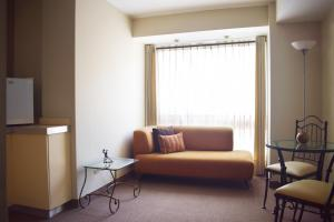 A seating area at Suites Antique Apart Hotel