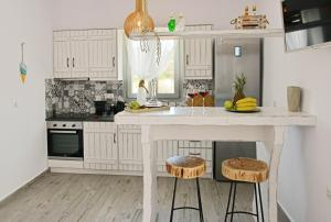 A kitchen or kitchenette at Naxian Album villa kaliope with private pool in Naxos