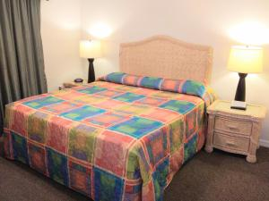 A bed or beds in a room at Grand Lake & Lifetime of Vacations Resorts