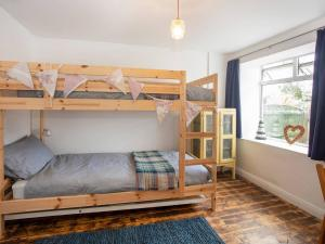 A bunk bed or bunk beds in a room at Ty Cefn