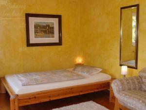 Ein Bett oder Betten in einem Zimmer der Unterkunft Ruhe auf dem Land
