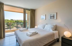 A bed or beds in a room at Herdade dos Salgados Beach