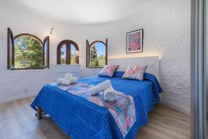 A bed or beds in a room at Villa Falco