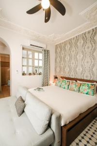 A bed or beds in a room at Casa MarAlta