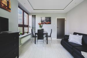 Svetainės erdvė apgyvendinimo įstaigoje P&O Serviced Apartments FABRYCZNA