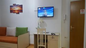 TV o dispositivi per l'intrattenimento presso Sweet Living Apartment