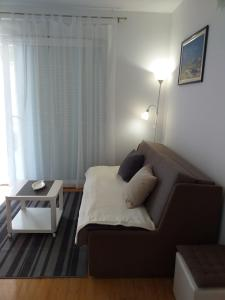 A bed or beds in a room at Apartman Bruna