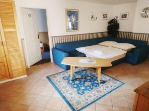 Ein Bett oder Betten in einem Zimmer der Unterkunft Alice Apartment House