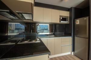 A kitchen or kitchenette at One Nk Apartments