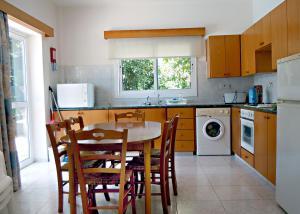 A kitchen or kitchenette at Rododafni Villas