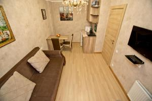 A seating area at Orbi bakuriani aparthotel 905