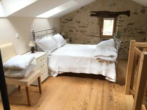 A bed or beds in a room at Aveyron Belle Vue