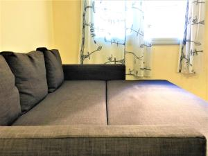 A bed or beds in a room at Lloret Beach Apartments