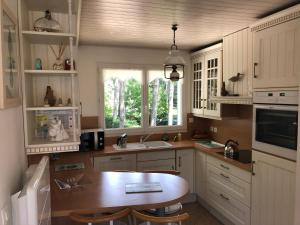 A kitchen or kitchenette at Maison Sapinettes
